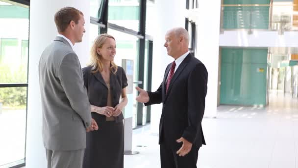 three businesspeople in relaxed discussion