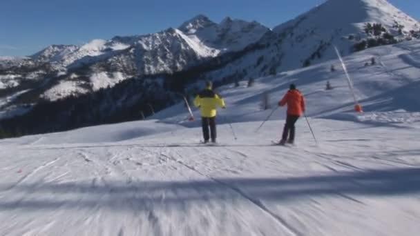Two skiers overtaken by cameraman