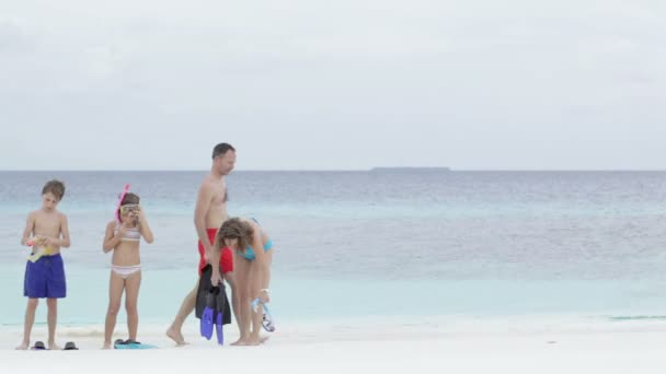 family with kids preparing for snorkeling