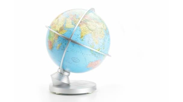 turning globe on white