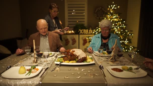 Senior people sitting at Christmas table