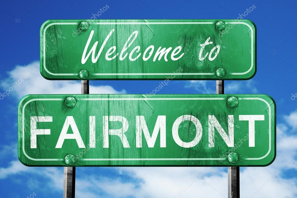 Fairmont vintage green road sign with blue sky background — Stock Photo ©  ellandar #106648618