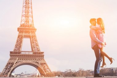young couple at Eiffel Tower