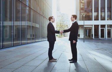 Handshake of two business men