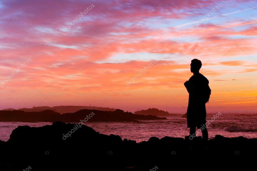 Backpacker enjoying sunset