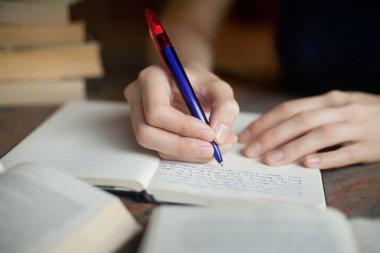 Child writing on notepad