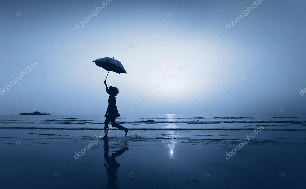 Small girl with umbrella