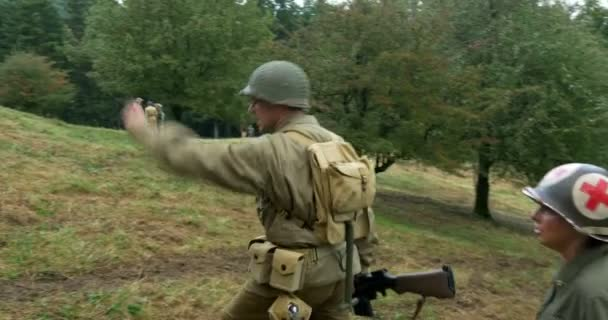 US soldiers patrol during a WWII reenactment