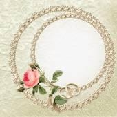 Esküvői háttér-val egy rózsa, gyöngy és jegygyűrű