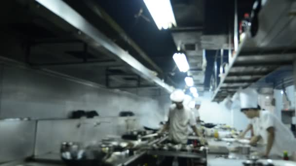 Motion chefs of a restaurant kitchen