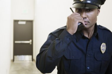 Security guard using a walkie-talkie