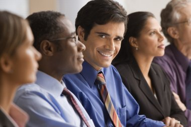 Businessman smiling at a meeting