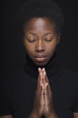 African woman praying