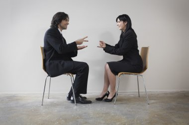 Businesspeople playing rock paper scissors