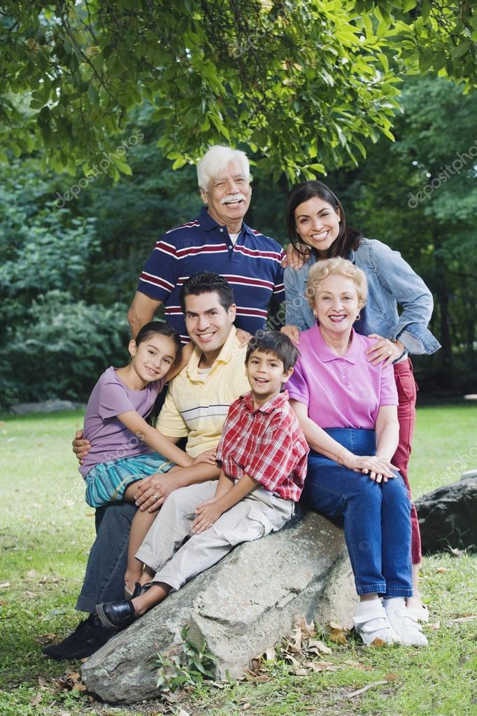 Multi-generational Hispanic family smiling in park