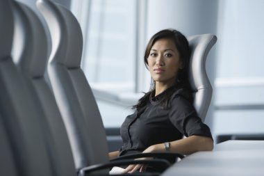 Asian businesswoman sitting in conference room
