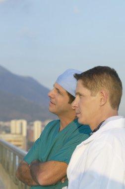 Two male doctors on balcony