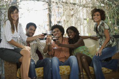 South American friends toasting at party