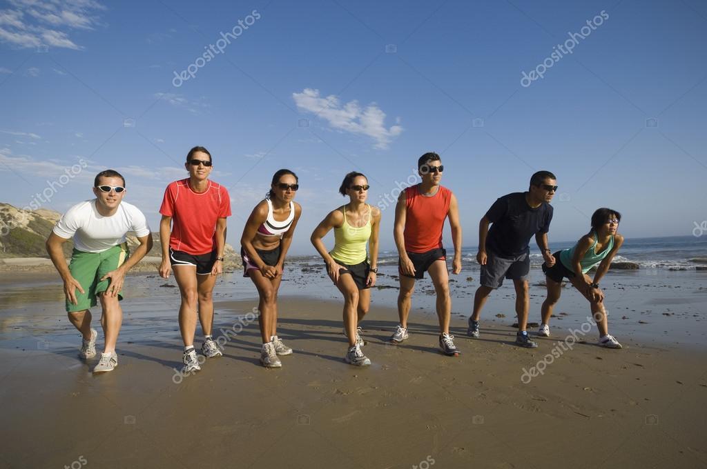 Multi-ethnic runners racing at beach