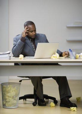 Businessman looking at laptop