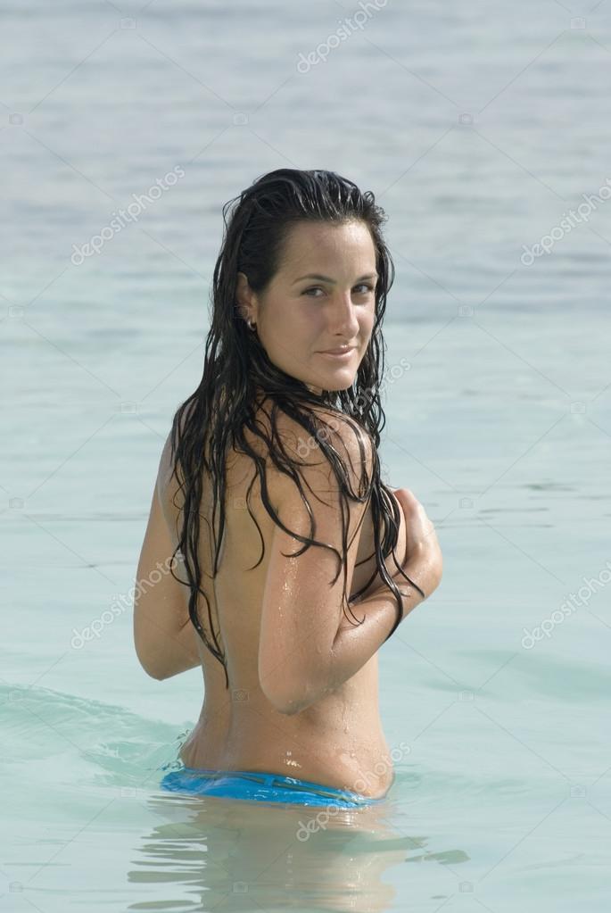 Semi-nude Hispanic woman in water