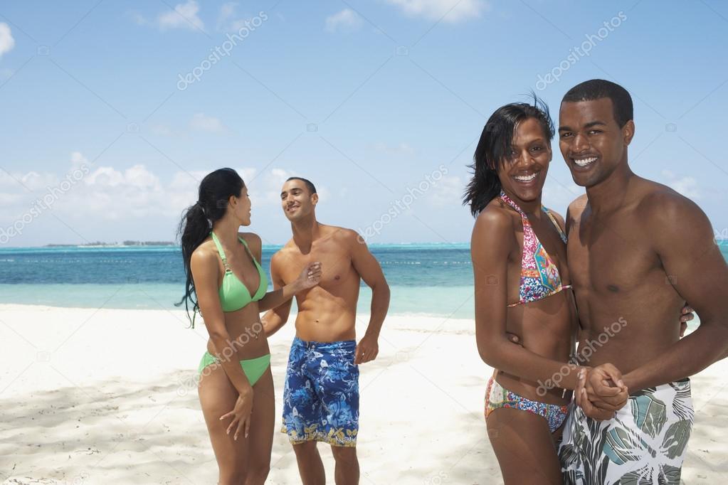 Multi-ethnic couples dancing on beach