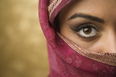 Middle Eastern woman wearing face covering