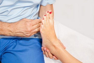 Doctor orthopedist examining feet