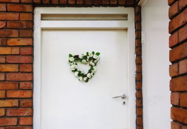 Wedding flower wreath on door