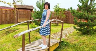 woman on a wooden bridge
