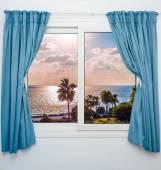 moře slunce z okna