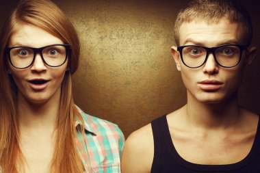 Eyewear concept. Portrait of gorgeous red-haired twins in casual