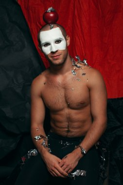 Backstage concept. Arty portrait of circus performer in black ti