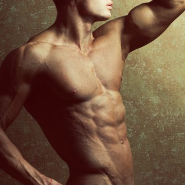 Bodybuilding and body sculpture concept. Beautiful (handsome) mu