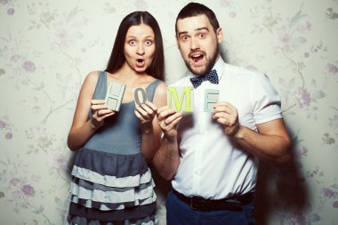 Home sweet home concept. Portrait of funny, happy couple of hipsters
