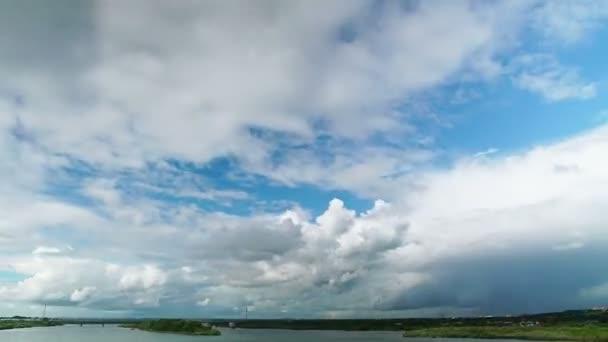 White cumulus clouds over landscape (time-lapse)