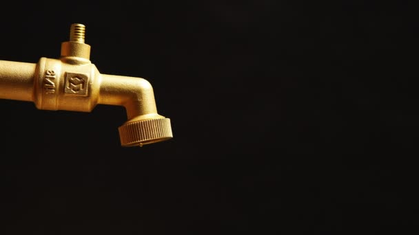 Dripping faucet on a black background