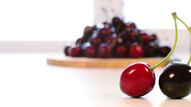 Fresh cherry and cherry jam jar in the background