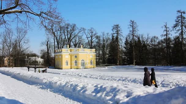 Upper Bathhouse and walking tourists in Pushkin city, St. Petersburg, Russia