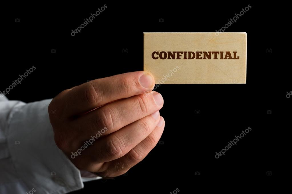Man with a business card reading - Confidential — Stock Photo ...