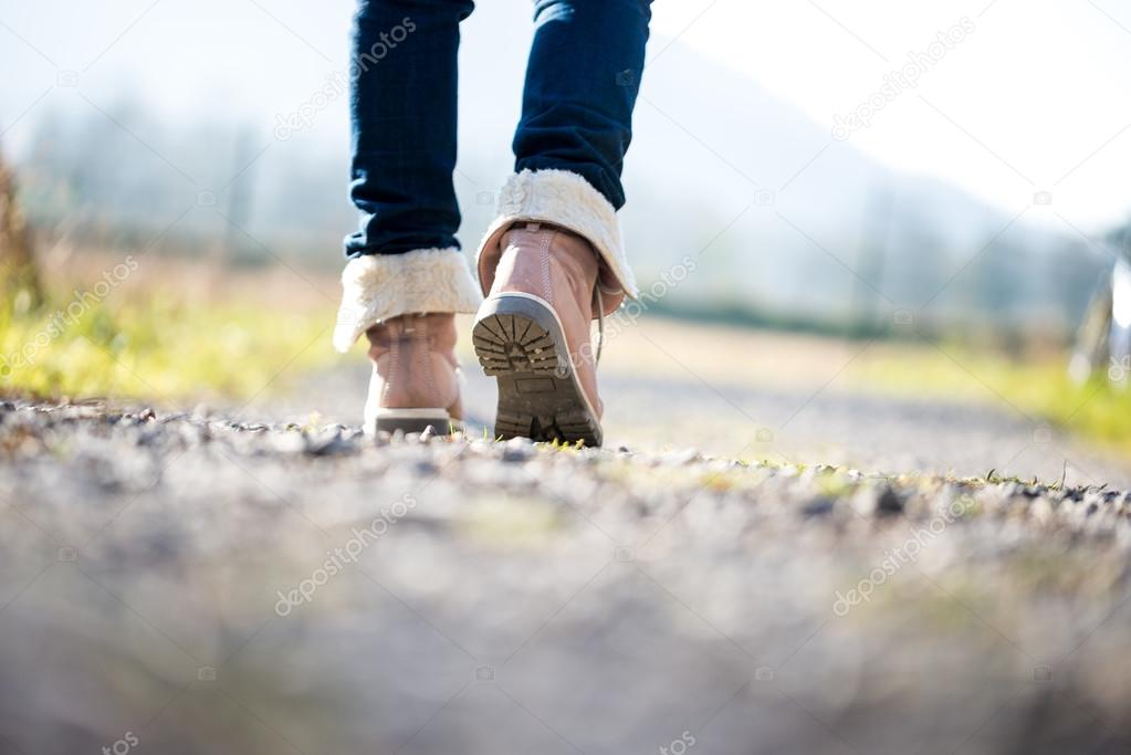 Woman walking along a rural path