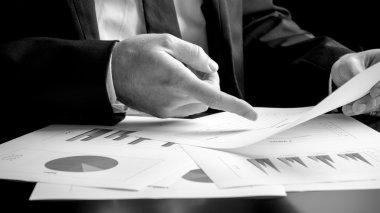 Businessman analysing a set of graphs