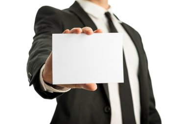 Business man holding blank card with copyspace ready for your te