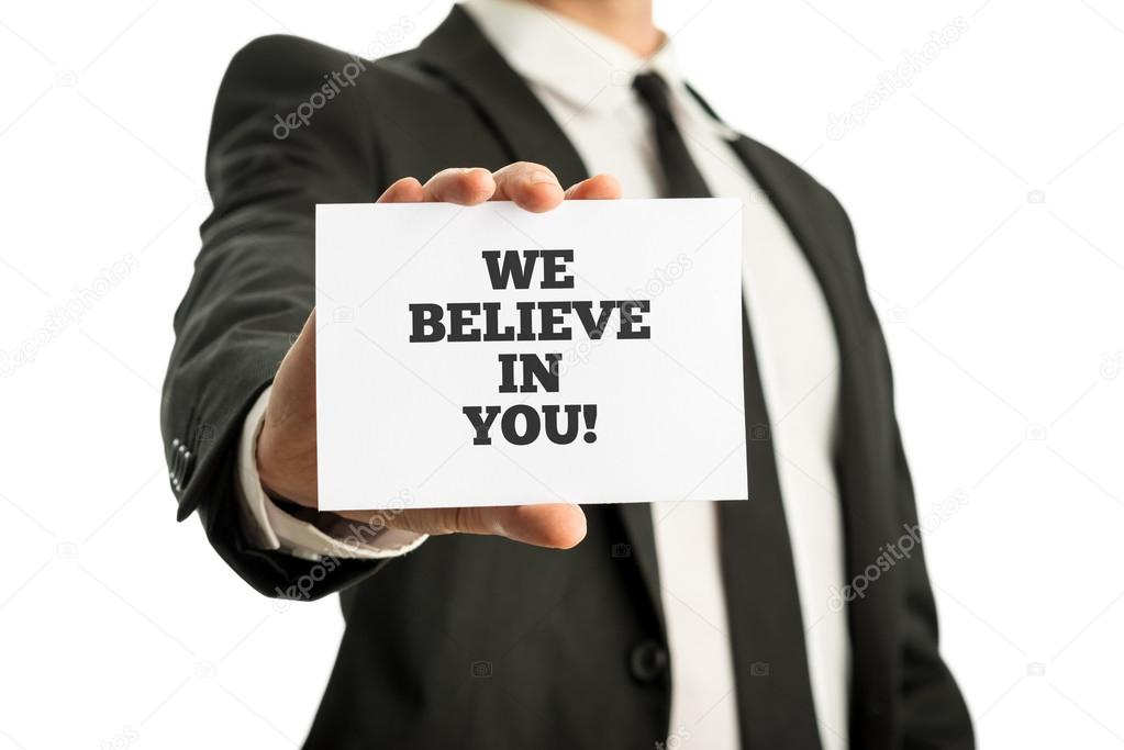 Business card with motivational message We believe in you — Stock ...