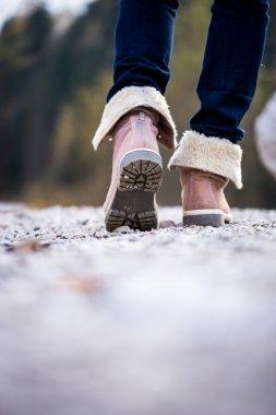 Closeup of a woman walking along a rural path