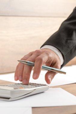 Businessman doing a calculation