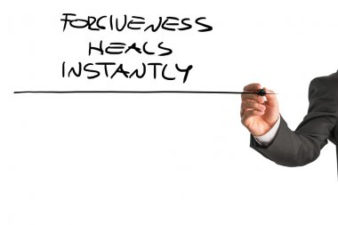 Professional therapist writing a Forgiveness heals instantly say