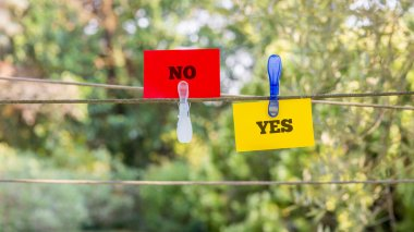 Paper with Yes and No Texts Clipped on a String