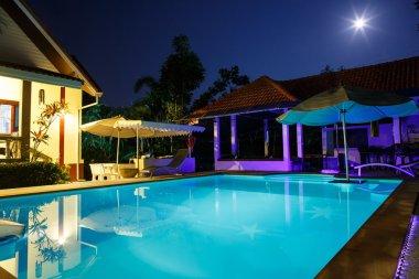 Villa with pool at night