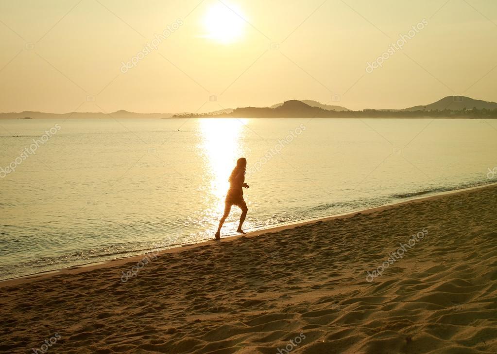 A man runs along the coast in the morning